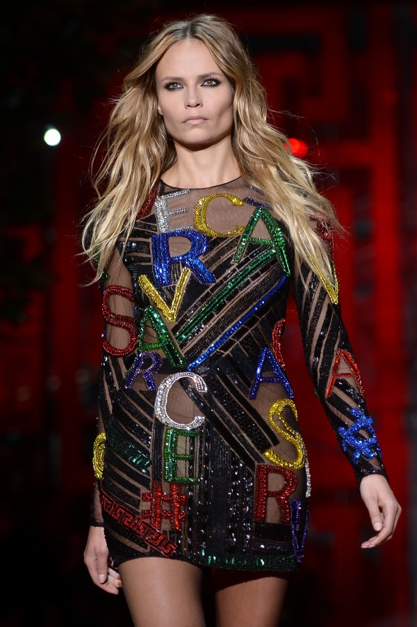 Model Natasha Poly presents a creation for fashion house Versace at the women Fall / Winter 2015/16 Milan's Fashion Week on February 27, 2015. AFP PHOTO / FILIPPO MONTEFORTE