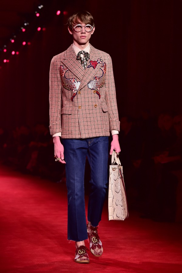 Showcased in all-red surroundings, Gucci's AW16-17 man rocked a retro and romantic style. Nature was a key trend in the collection, cropping up in details such as flower prints and birds. Gucci was big on color too, using lots of pink, yellow and red. AFP Photo