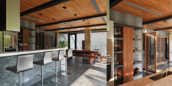 The wooden shelving in the first floor kitchen is designed by Ryan Kuo. View of the kitchen on the first floor.