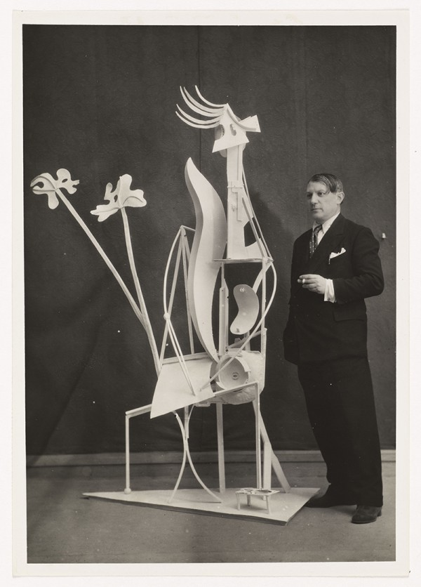 "Picasso next to ""Woman in the Garden"" at the exhibition of his work at Georges Petit's gallery, Paris, June 16 to July 30, 1932."