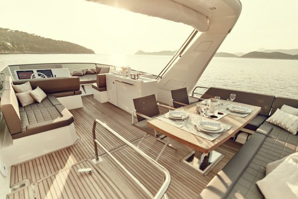 The extra large flybridge is broken up into three areas: the helm and observation seating
