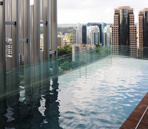 The Marq in Singapore features cantilevered 15-metre pools from the building's glass facade