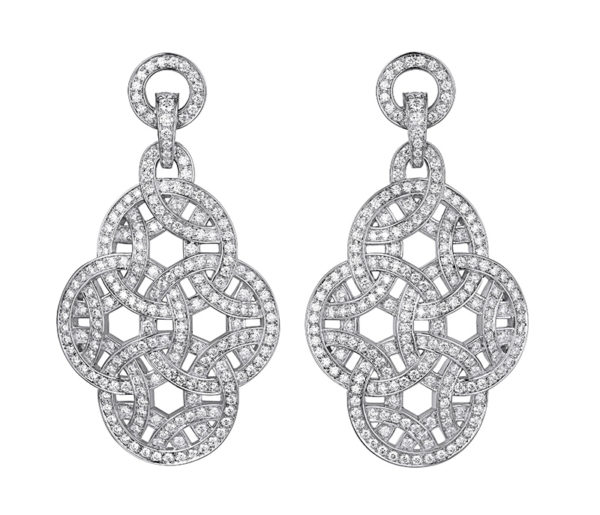 Designed for the Parisian woman, stunners in Cartier's Paris Nouvelle Vague collection are some of Sofia Coppola's favourite. White gold earrings with diamonds.