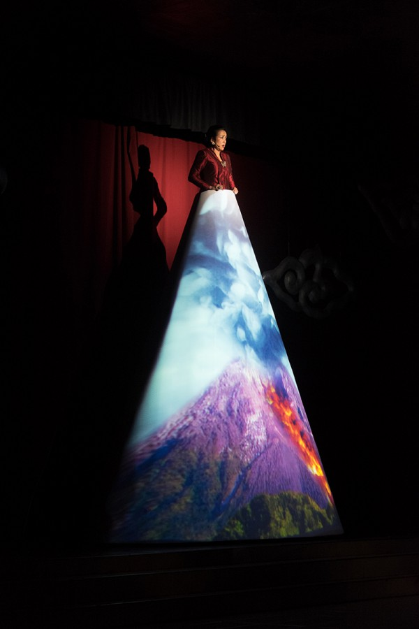 AR,-Astari-chanting-on-huge-cone-w-video-mapping-of-exploding-Mt-Merapi