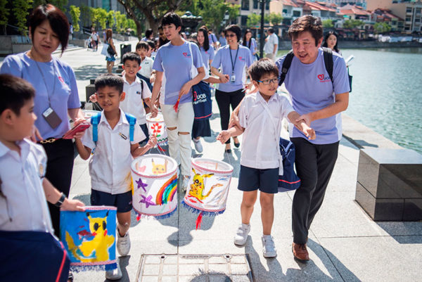 photo-2_apsn-students-walk-along-the-singapore-river-to-commemorate-the