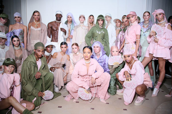 Rihanna posing with models from the Fenty X Puma runway show.