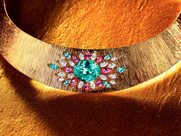 Piaget Sunny Side of Life necklace with one oval-cut Paraiba tourmaline centre stone from Mozambique, and diamonds, pink sapphires and blue tourmalines
