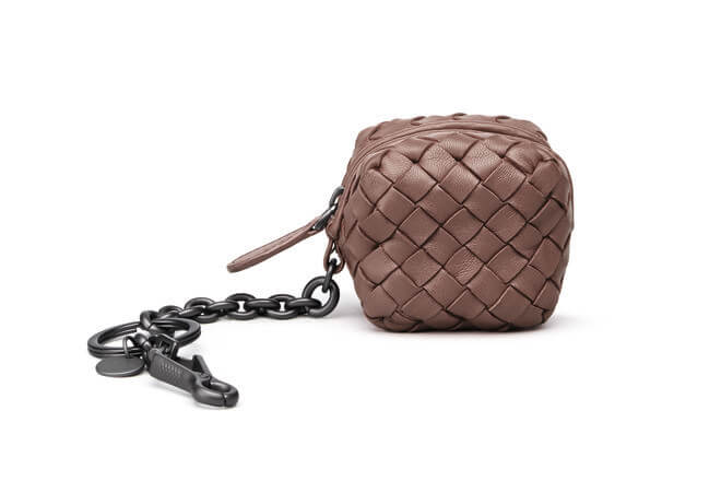 66eb714399 A Bottega Veneta Wristlet for her nights out — less is more they say