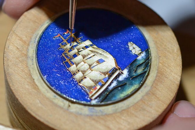 A dial in cloisonné enamel is in the making