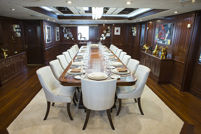 The stately dining area of the Chakra superyacht