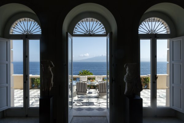 "Can you believe this is the ""basement"" of the Villa Astor Sorrento? Huge arched windows offers a beautiful view of the sea and Mount Vesuvius."