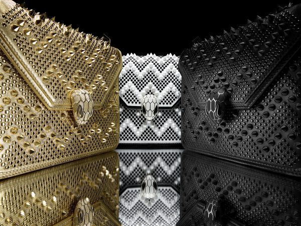From left: Serpenti Forever by Nicholas Kirkwood, Flap Cover, Stud Chevron Gold/Nappa Gold; Stud Chevron White Ceramic/Black/Calf leather black and Stud Chevron black/Calf leather black. Retail price: SG$3980