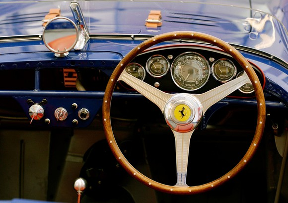 "Dashboard view of the royal blue 500 Mondial Pinin Farina spider (1954), one of only 14 open-top models of this series built by Pinin Farina. Onboard computers weren't a ""thing"" yet."