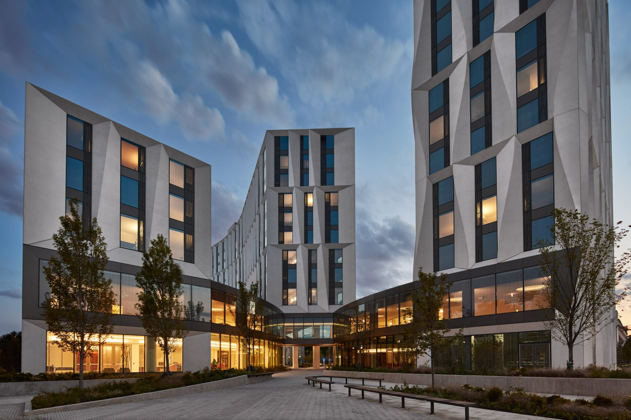 Tom Harris Photography provides an emotive shot of US firm Studio Gang's student residential complex for the University of Chicago that features towers sheathed in glass and sculptural panels