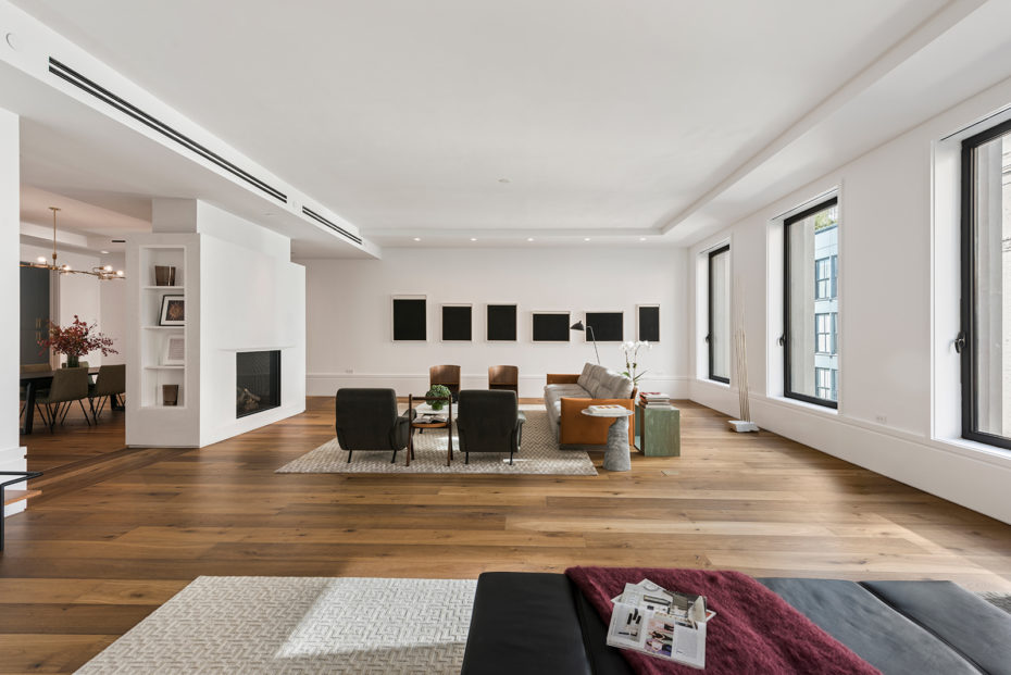 Large Plank White Oak Floors 18 Inch Millwork Baseboards Spanning The Ious 800 Square Feet New York Loft Also Features Integrated Lighting
