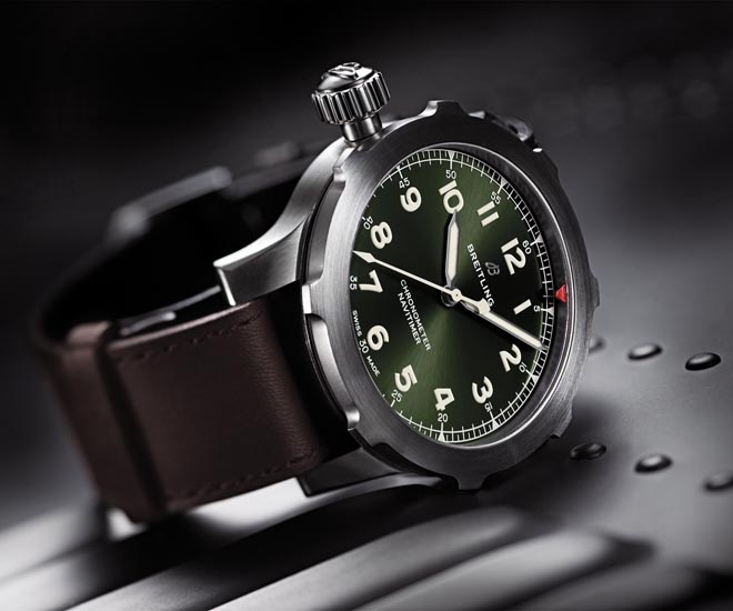 The new Breitling Navitimer Super 8 is available in two iterations: stainless steel with a black dial, and titanium paired with a green dial.