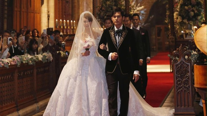 Jay Chou walks down the aisle with bride Hannah Quinlivan.