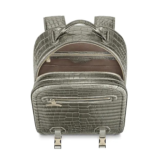 39b2eedea341 The outstanding Louis Vuitton leather backpack is crafted from rare  crocodilian leather in Titanium grey