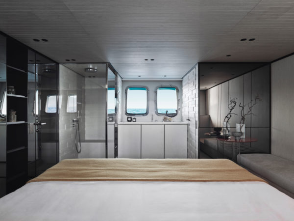 The master suite features a starboard-facing bed and an elegant, open-design bathroom