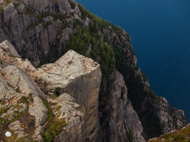 Preikestolen is a steep cliff that rises 604m and offers remarkable views from its flat top