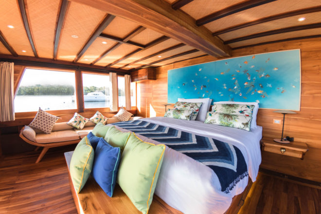 The master suite on Magia II faces an aft private deck with jacuzzi