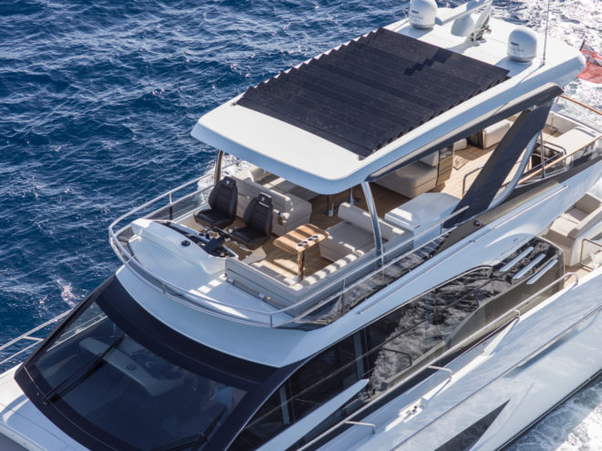 The Squadron 68 has a large flybridge and a hardtop featuring pivoting slats that can be partially or fully open, or completely closed