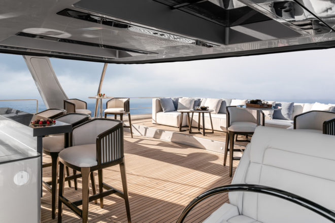The flybridge has a karaoke bar, cocktail tables and oversized lounging sofa