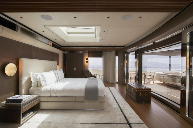 The forward master suite has a large bed that enjoys an open view