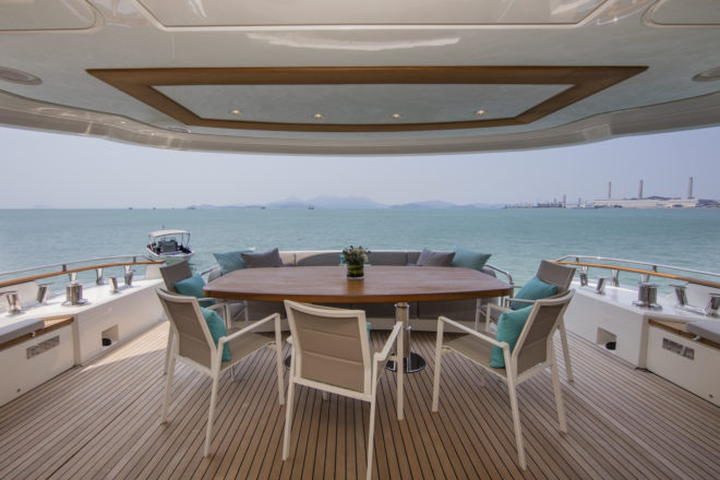 The covered aft cockpit (above) and multi-functional foredeck (below) are among the popular outdoor areas on the 86ft yacht, which is in Hong Kong and available