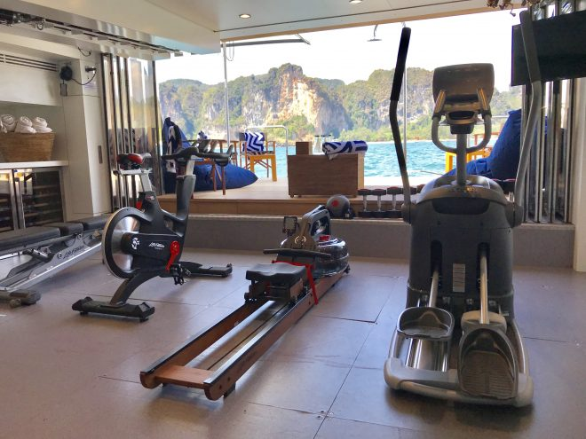 The air-conditioned gym on Lady Azul has a great sea view